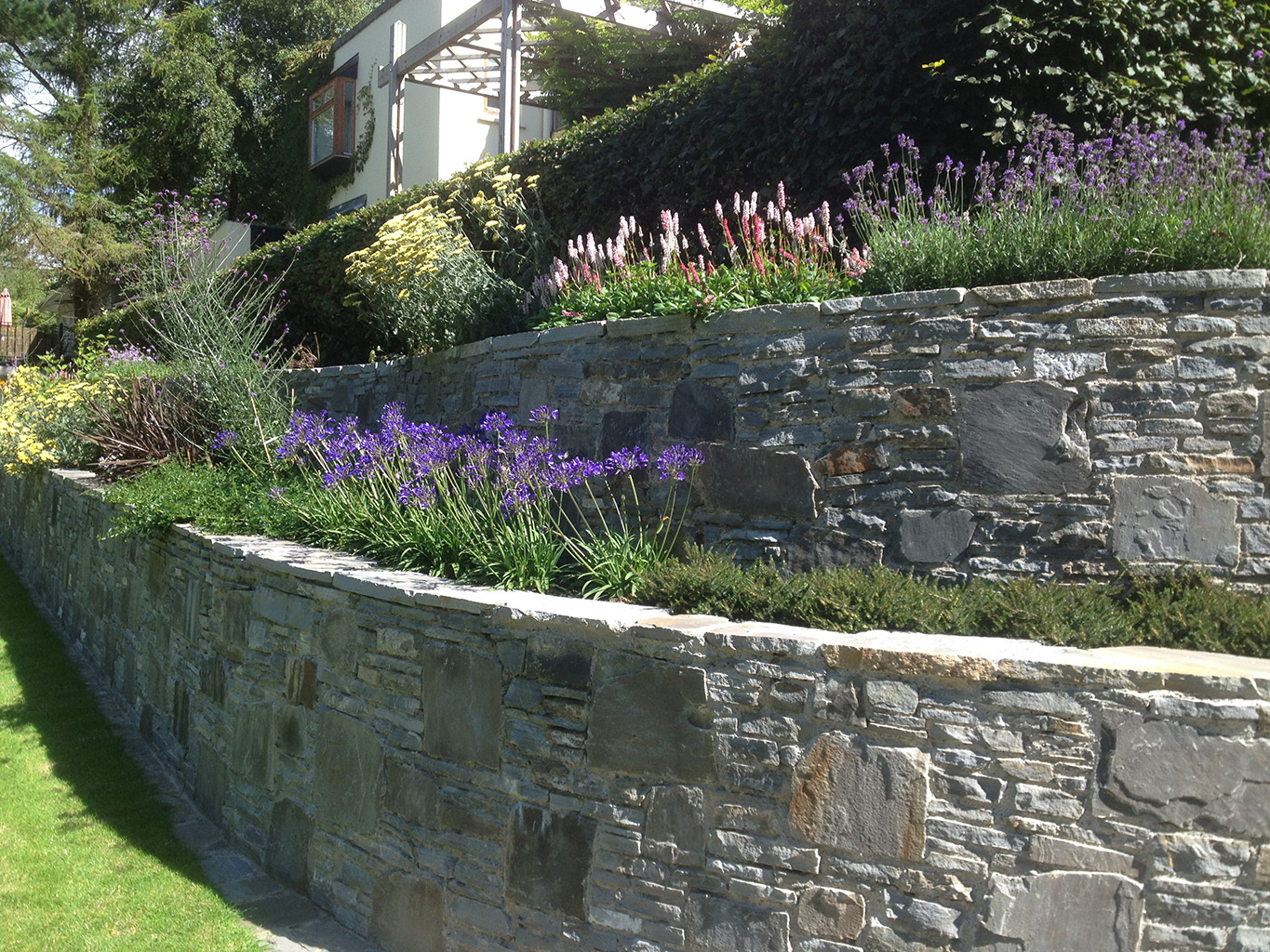 large retaining wall with steps in athy built with irish limestone the location was athy co kildare this project was completed in summer 2014